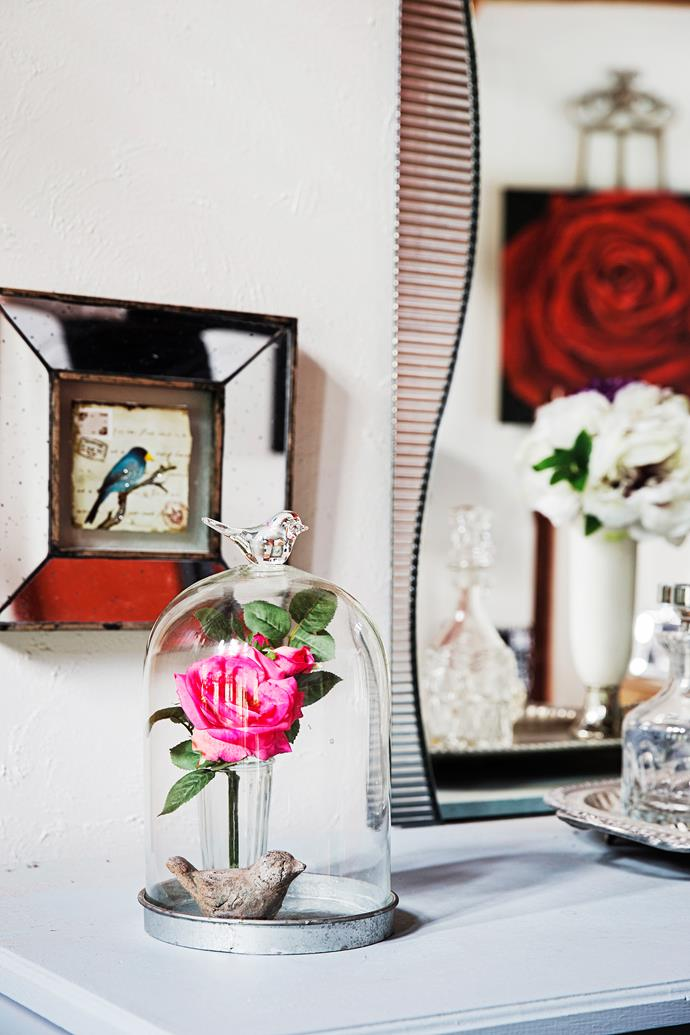 A glass cloche is a lovely way to display Lorraine's ornaments and one of her home-grown roses.