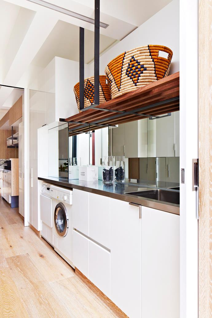 "A galley-style laundry is concealed alongside the scullery in this open-plan Melbourne home designed by architecture firm [Multiplicity](http://www.multiplicity.com.au/?utm_campaign=supplier/|target=""_blank""). It includes an airing cabinet, and handle-free cabinetry ensures the laundry flows seamlessly into the kitchen area. Woven **baskets** from [Orient House](http://www.orienthouse.com.au/?utm_campaign=supplier/