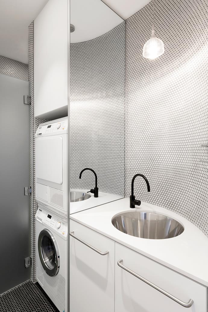 "Architect [Tom Ferguson](http://www.tfad.com.au/?utm_campaign=supplier/|target=""_blank"") used hexagonal floor-to-ceiling mosaic tiles in this compact laundry in a Sydney terrace. Adding a mirrored wall panel creates the illusion of more space. Black Icon mixer **tap** from [Astra Walker](http://www.astrawalker.com.au/?utm_campaign=supplier/