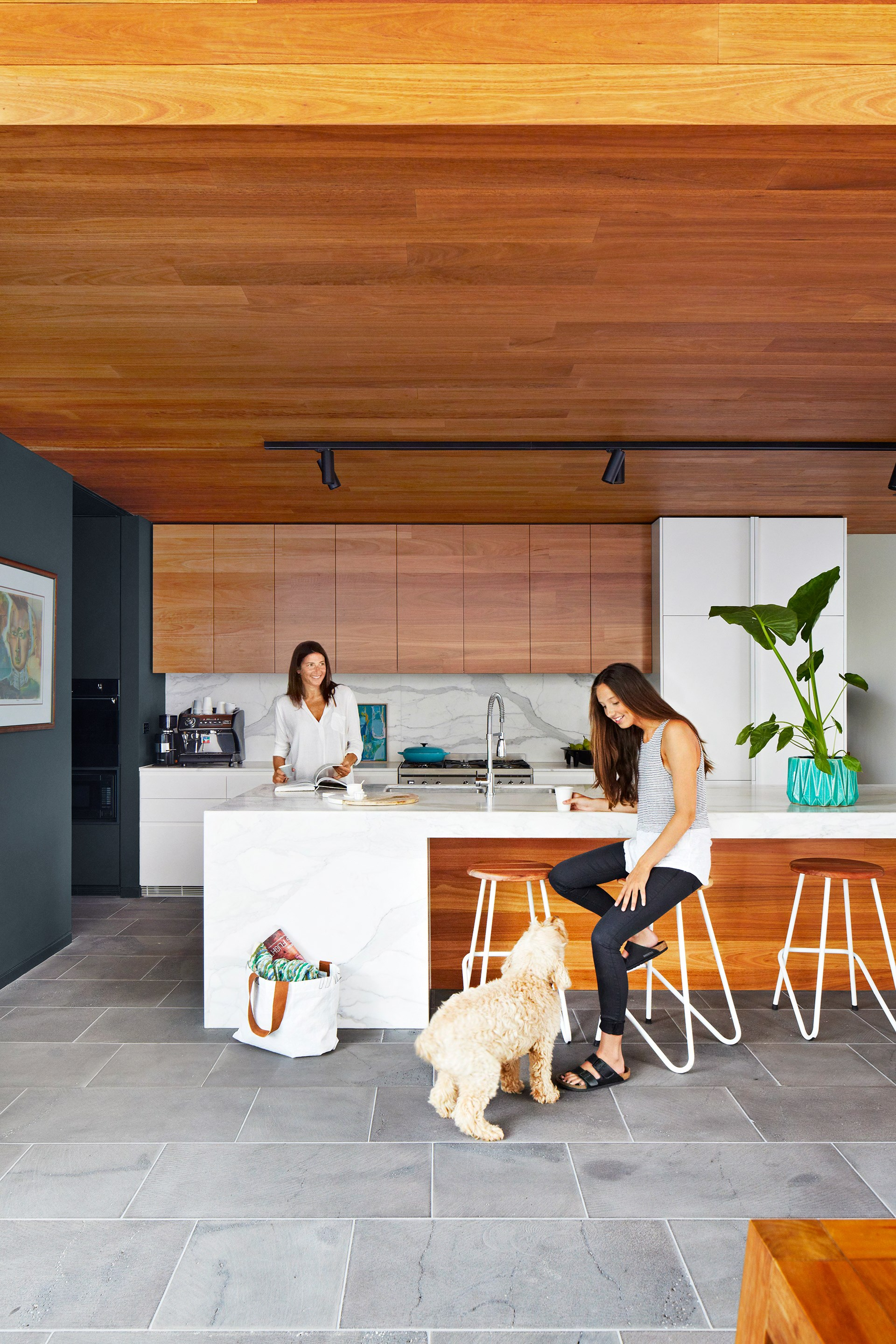 A blackbutt timber clad ceiling adds warmth and coziness to the streamlined kitchen within this [Modernist Melbourne home](http://www.homestolove.com.au/gallery-stephen-and-tanyas-melbourne-home-reno-2286). *Photo: Armelle Habib*