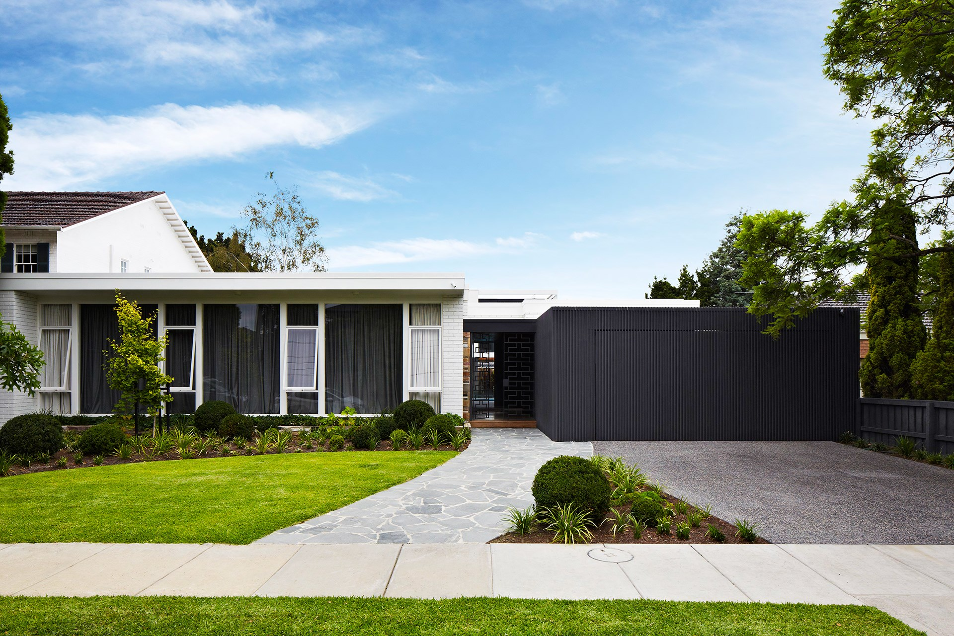 A contemporary colour scheme of charcoal and white works wonders on this 1960s single-storey dwelling. Find out more about this [Melbourne home reno](http://www.homestolove.com.au/gallery-stephen-and-tanyas-melbourne-home-reno-2286). Photo: Armelle Habib / *Australian House & Garden*