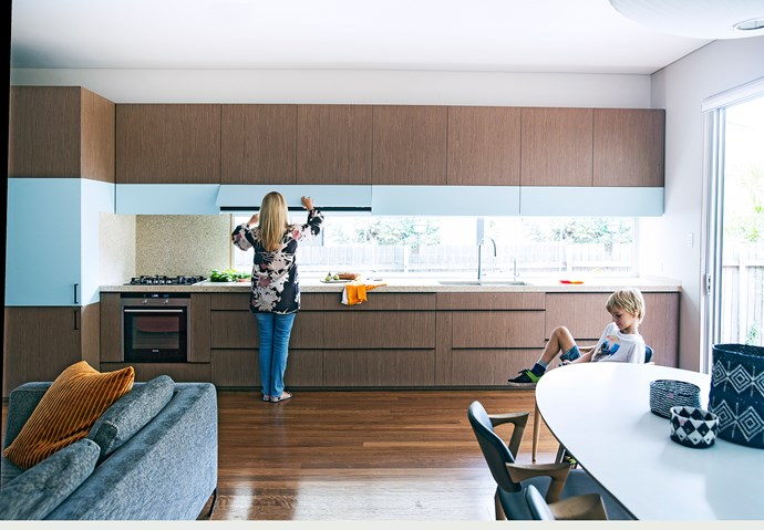 This straight-line kitchen in Bondi contains fully integrated appliances within the joinery to minimise visual clutter. Photo: Chris Warnes