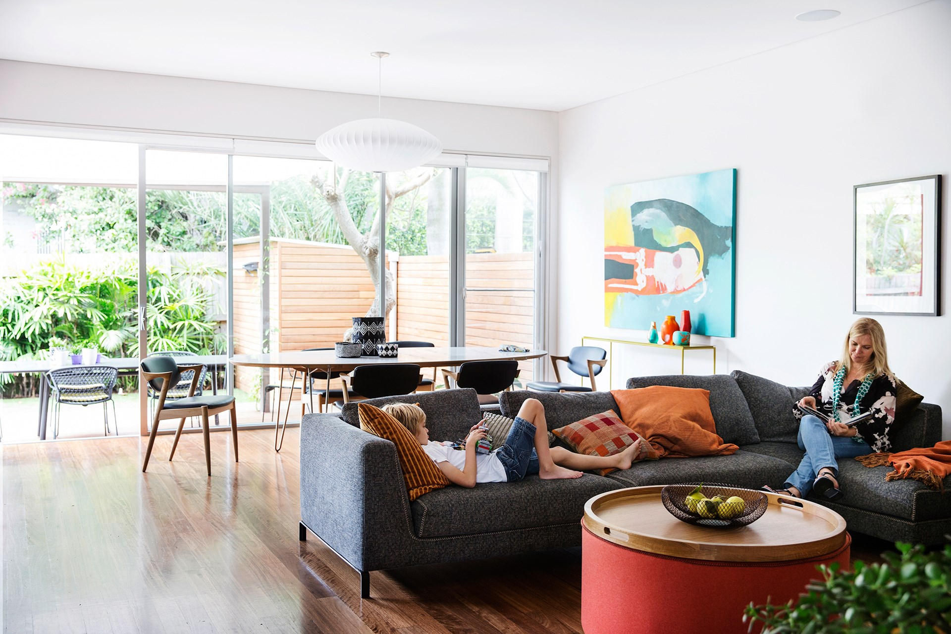 """A smart renovation turned this 1930s Sydney semi into a home its owners love to spend time in. A sliding glass door and window that can be opened right up maximise airflow, while a mature frangipani tree and external awning keep hot rays at bay. On really warm days, the blinds can be lowered to keep the home cool. [See more of this house](http://www.homestolove.com.au/gallery-julie-and-hamishs-renovated-sydney-semi-2290