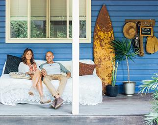 Couple on a weatherboard verandah on NSW's North Coast