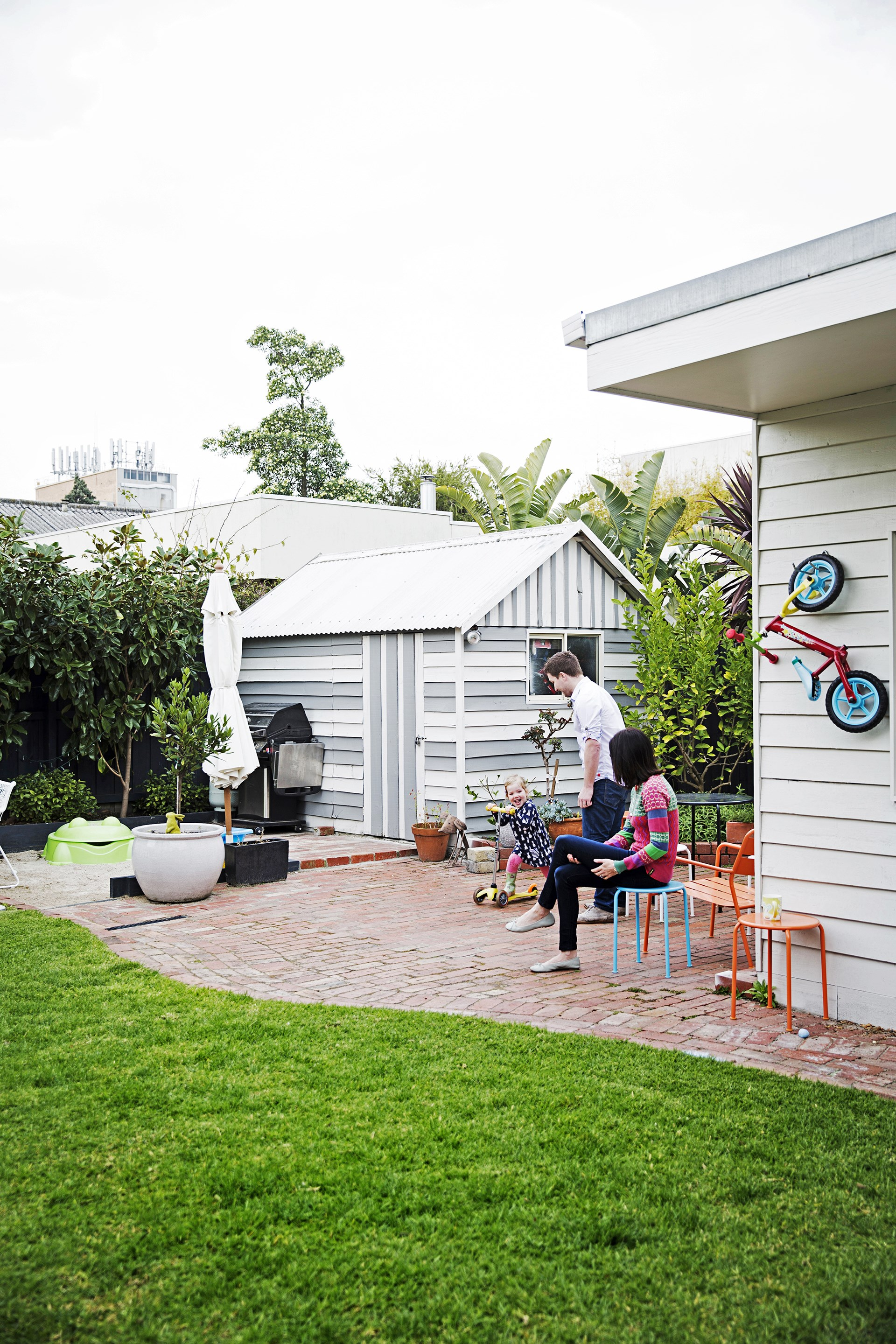 "Hard surfaces in the backyard of their [Melbourne bungalow](http://www.homestolove.com.au/gallery-claire-and-olivers-growing-family-home-2308|target=""_blank"") work well for this young family. Photo: James Henry / *homes+*"