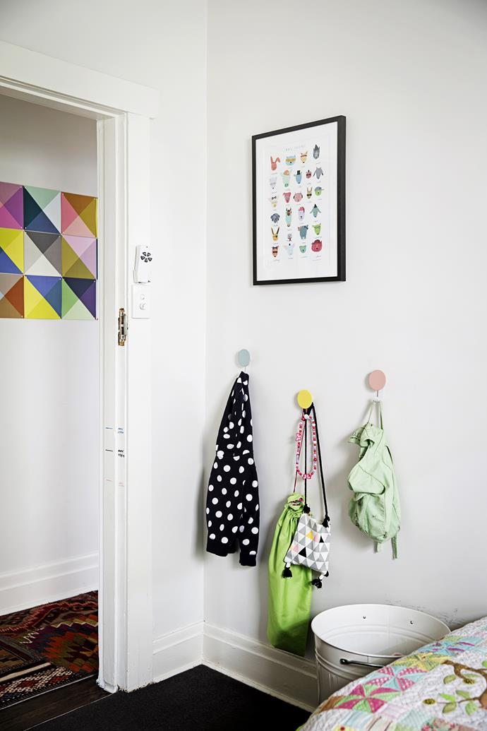 Claire hung hooks at the girls' height to encourage them to put their belongings away!