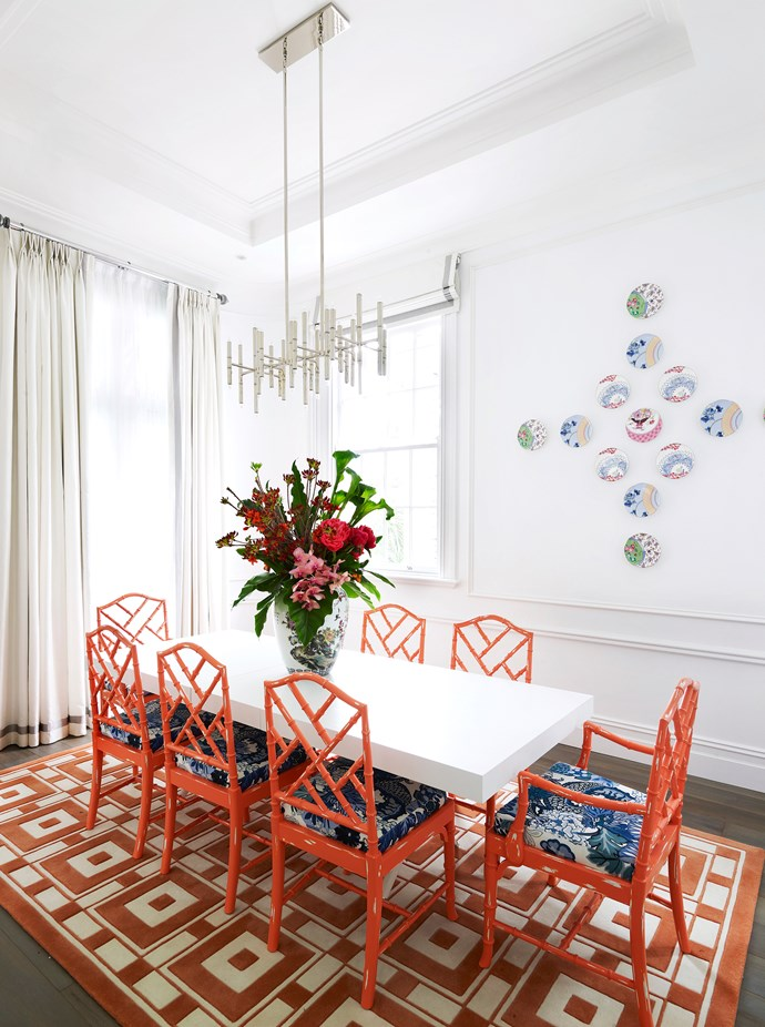 "The cheerful dining room is Emma's favourite element of her home renovation. ""It's brave, with its coral-coloured chairs and rug, as well as the Wedgwood plates on the wall,"" she says. ""It's sunny and fun, without any sense of gimmickry."" Faux bamboo **chairs** from [Casa Mia](http://casa-mia.com.au/?utm_campaign=supplier/