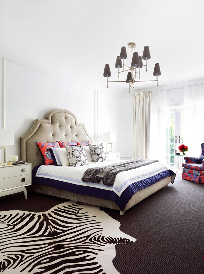 "Red and navy add pizazz to the main bedroom, which was once the old upstairs apartment's living room. French doors and balconies off the first floor rooms ensure a strong indoor-outdoor connection. Woodhouse **bed** and Claude **bedside tables** from [Jonathan Adler](http://www.jonathanadler.com/?utm_campaign=supplier/|target=""_blank""). **Bedlinen** from [Williams-Sonoma](http://www.williams-sonoma.com.au/?utm_campaign=supplier/