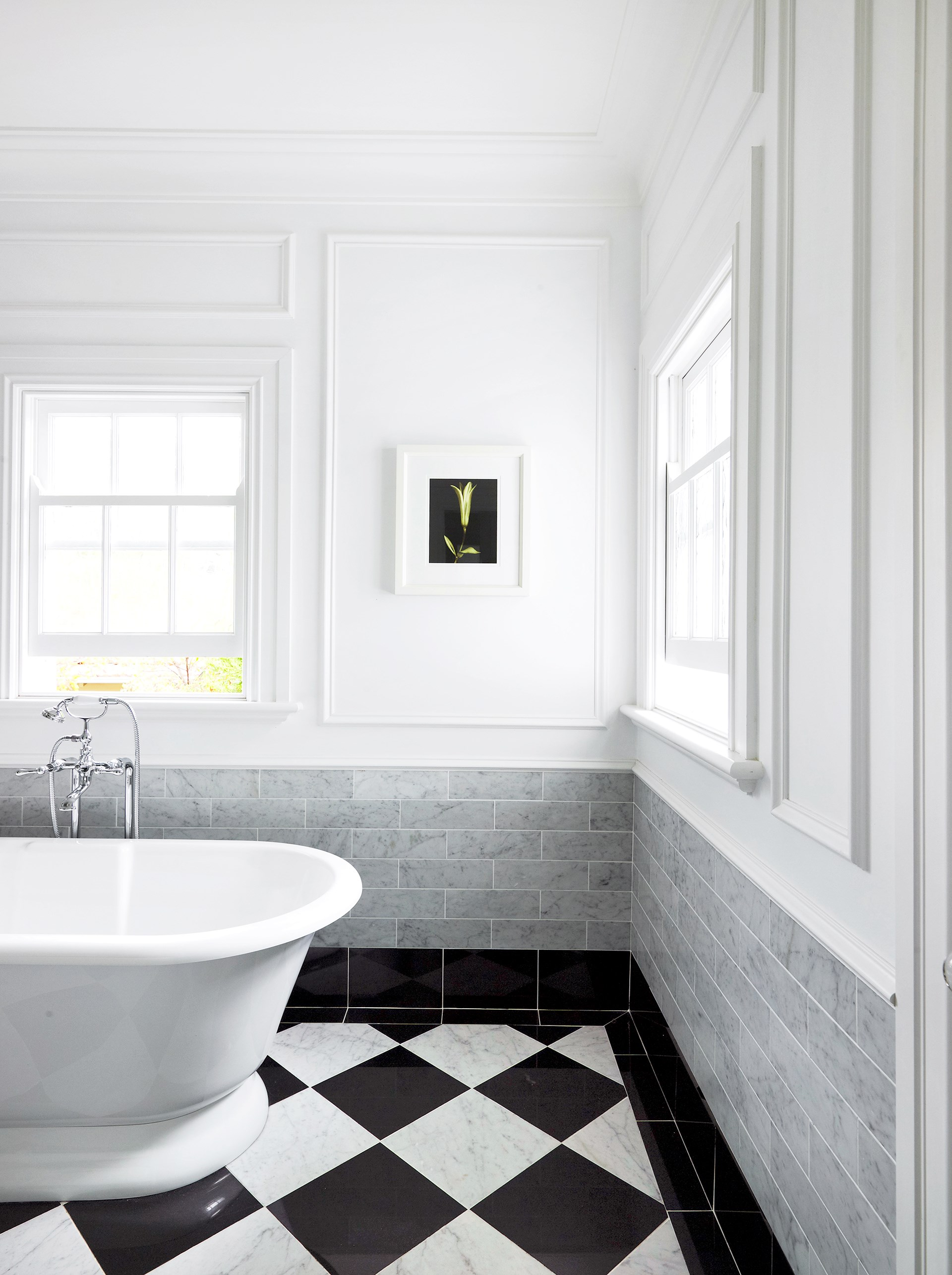 The Art Deco style of this 1940s [Sydney apartment](http://www.homestolove.com.au/gallery-emma-and-tonis-luxurious-regency-style-home-2311) travels right through to the tranquil ensuite where bold floor tiles contrast seamlessly with the fresh white walls. *Photo: Anson Smart / Belle*