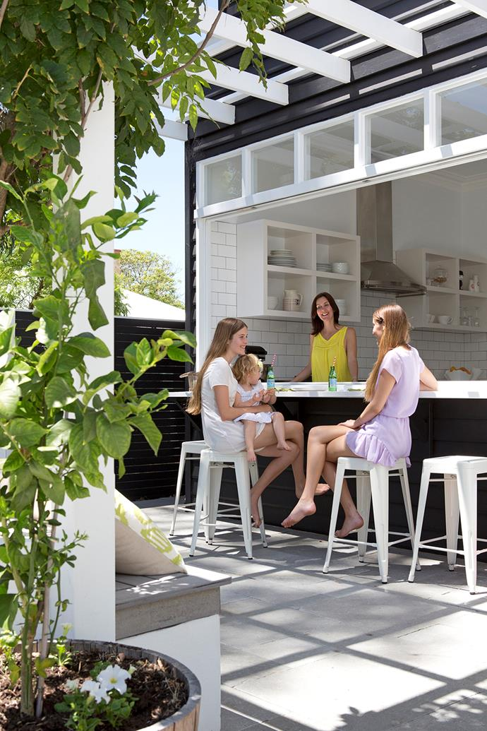 """The servery: Family members gravitate to the indoor/outdoor servery for snacks and chats.  Industrial stools from [Mocka](http://www.mocka.com.au/?utm_campaign=supplier/