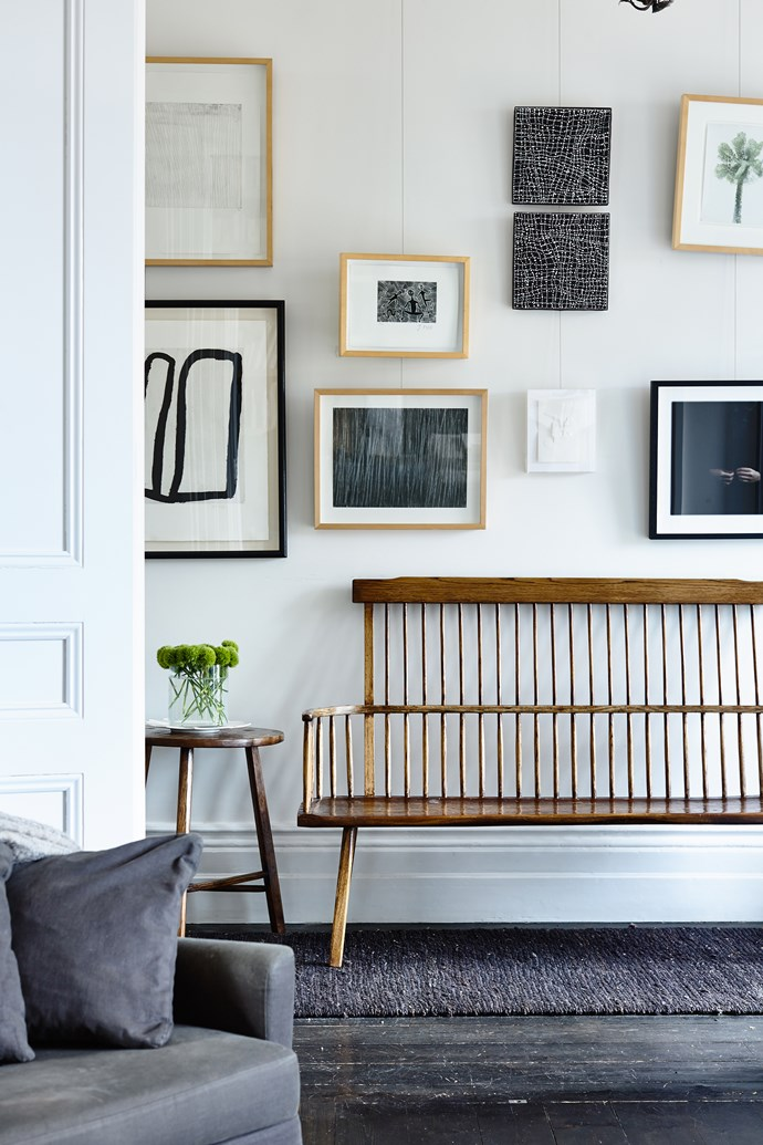 """The bright white walls in the hallway are the ideal backdrop for artworks by (clockwise from top left) Kitty Kantila, Jimmy Pike, Dorothy Napangardi, Sidney Nolan, Sophia Szilagyi, Le Corbusier, Cy Twombly and Rover Thomas.  **Bench** and **side table** by [Greg Stirling](http://gregstirlingfurniture.com?utm_campaign=supplier/