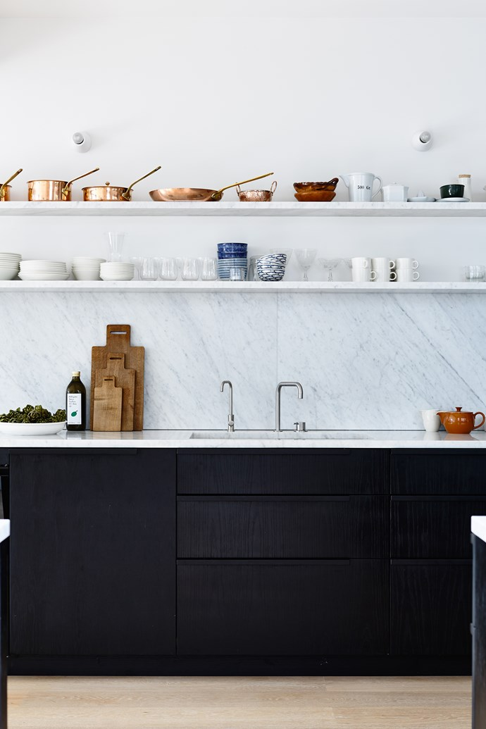 Open shelving adds a decorative element to the kitchen and in this instance shows off a collection of gleaming copper cookware.