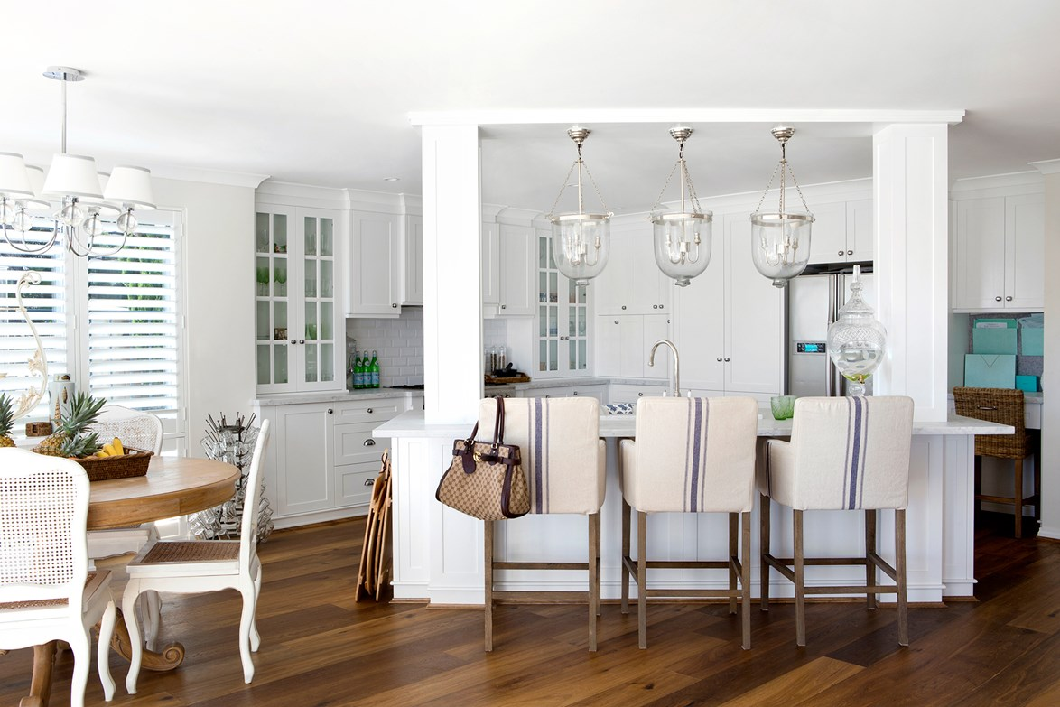 "With kitchen stools upholstered in Ralph Lauren Home fabric, glass pendant and shaker cabinetry, this kitchen looks like its been plucked straight out of [The Hamptons](https://www.homestolove.com.au/a-hamptons-inspired-holiday-home-south-of-perth-5122|target=""_blank""). Photo: Angelita Bonetti / *Australian House & Garden*"