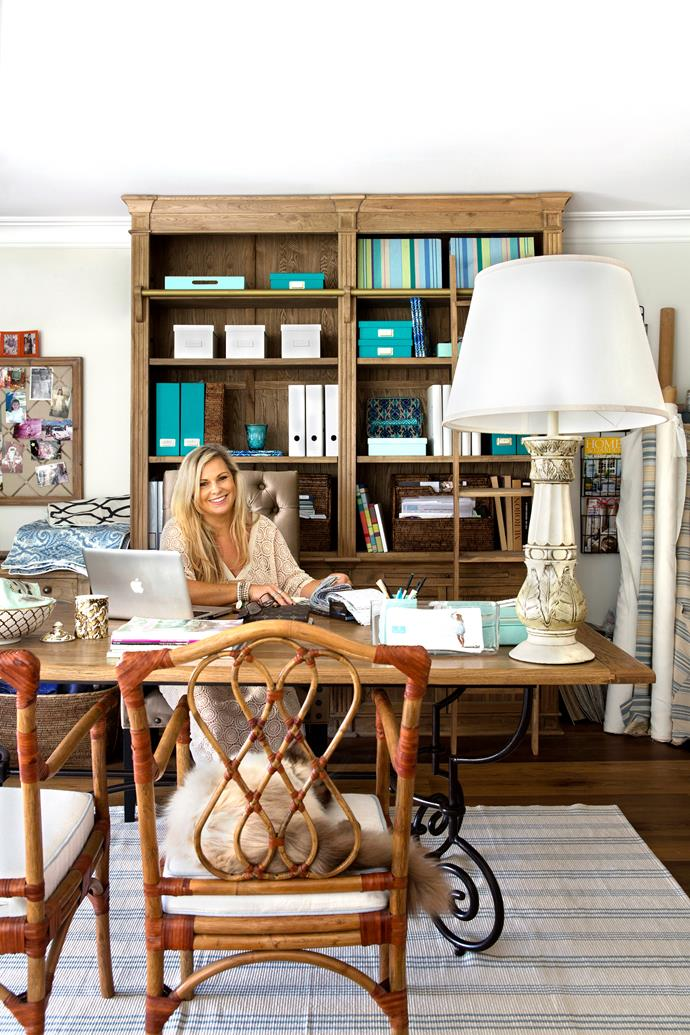 "Natalee checks swatches in her mezzanine workspace, while Himalayan cat Coco takes a nap.  **Desk** and **bookcase** from [Restoration Hardware](https://www.restorationhardware.com/?utm_campaign=supplier/|target=""_blank""). **Chairs** and **lampshade** from [Indah Island](http://www.indahisland.com/?utm_campaign=supplier/