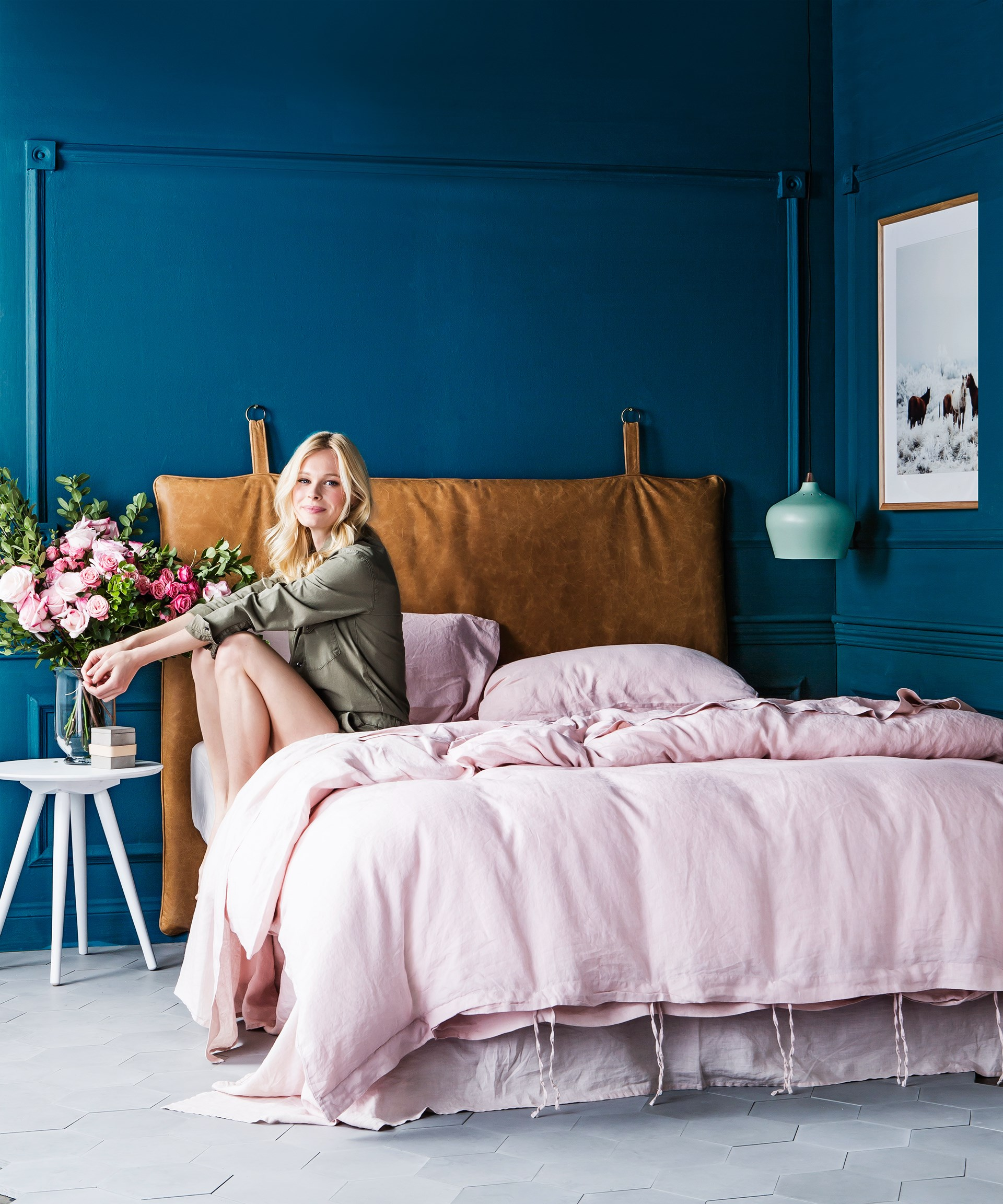 """Mix different textures like sumptuous linen and natural leather with dramatic blue-green walls for a [dreamy bedroom space](http://www.homestolove.com.au/dreamy-bedroom-accessories-2318