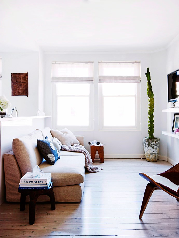 """Smart furniture purchases, such as the sofa bed in this renovated Sydney apartment, serve a family room well and provide handy guest accommodation. The petite space is bright and airy, with bamboo blinds providing privacy without blocking the light.  Sofa bed from [Jardan](http://www.jardan.com.au/?utm_campaign=supplier/