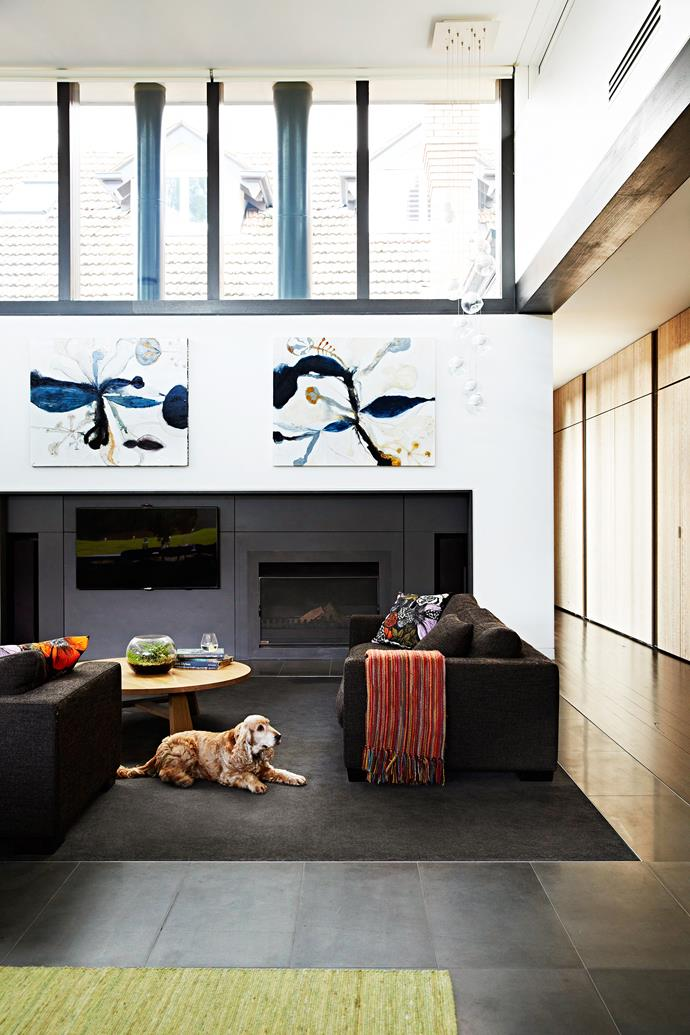 "An abundance of natural light is an asset to any room. In the case of this Melbourne family room, soaring clerestory windows have given architect Geoff Challis of [Venn Architects](http://www.vennarchitects.com/?utm_campaign=supplier/|target=""_blank"") licence to define and anchor the room with deep, seductive tones.  Condo Plush **carpet** in Raven from [Godfrey Hirst](http://www.godfreyhirst.com/?utm_campaign=supplier/
