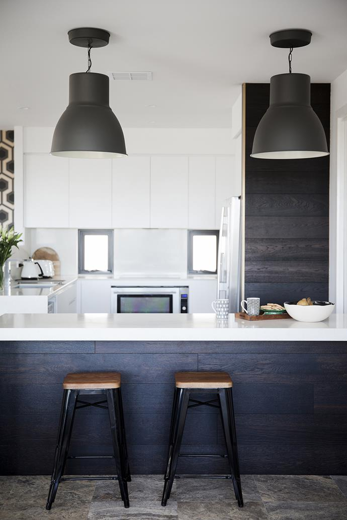 """Black replica Tolix stools are used at the island bench and an [Ikea](http://www.ikea.com/au/?utm_campaign=supplier/