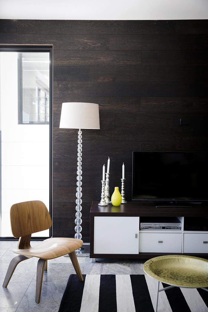 """A dark wood wall harmonises with the silver travertine floor. A [Freedom](http://www.freedom.com.au/?utm_campaign=supplier/