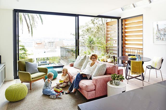 "Sarah, Ella and Daniel enjoy some family time in the lovely and light ground-floor living room. Sisal rug from [International Floorcoverings](http://www.interfloors.com.au/?utm_campaign=supplier/|target=""_blank""). Dining table from [Exhibit Interiors](http://www.exhibitinteriors.com.au/?utm_campaign=supplier/