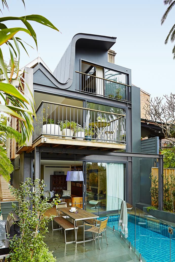 "The eye-catching S-shaped roof caps off the modern rear addition. **Outdoor setting** from [Urban Balcony](http://www.urbanbalcony.com.au/?utm_campaign=supplier/|target=""_blank""). Frameless-glass pool fence from Romano Glass Service."