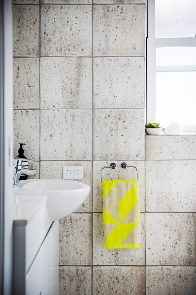 "A vibrant towel makes a statement against the grey stone wall tiles in the bathroom.  Duo bath **towel** from [Aura By Tracie Ellis](https://www.aurahome.com.au/?utm_campaign=supplier/|target=""_blank"")."