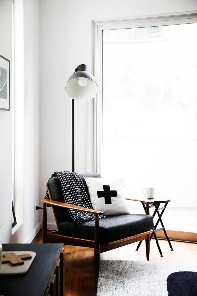 "An original '50s Parker chair was a gift from Clare's dad. It's the perfect reading spot with a dark powdercoated floor lamp above.  Hektar floor lamp in Dark Grey from [Ikea](http://www.ikea.com/au/en/?utm_campaign=supplier/|target=""_blank"")."