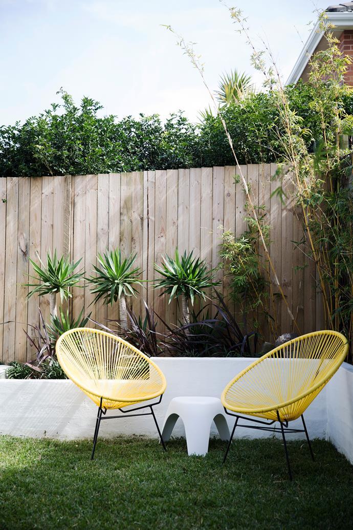 "Replica Acapulco chairs from [Matt Blatt](http://www.mattblatt.com.au/?utm_campaign=supplier/|target=""_blank"") bring a little sunshine to the backyard."