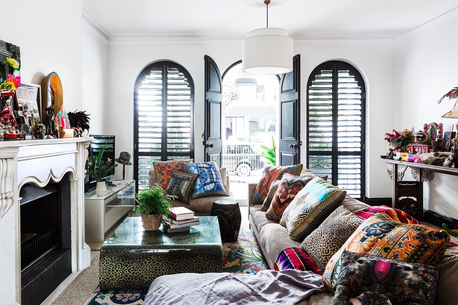 Fashion designer [Camilla Franks](http://www.homestolove.com.au/gallery-the-eclectic-home-of-designer-camilla-franks-2355) likes to crowd her sofa with scatter cushions in clashing prints. Photo: Maree Homer / *Australian House & Garden*