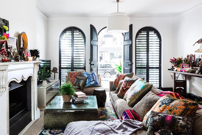 "The sofa, armchair and coffee table all came from Camilla's previous home. Cushions from [Camilla](https://www.camilla.com.au/?utm_campaign=supplier/|target=""_blank""). Camilla island song rug from [Designer Rugs](http://www.designerrugs.com.au/?utm_campaign=supplier/