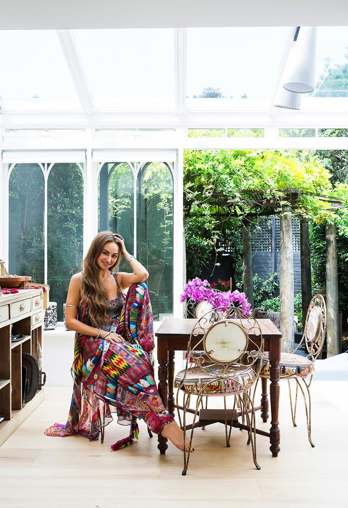 "Camilla sits at an antique dining table in the serene surroundings of her conservatory-style kitchen/dining space.  Seat **cushions** from [Bondi Markets](http://www.bondimarkets.com.au/?utm_campaign=supplier/|target=""_blank""). **Sideboard** from [Mitchell Road Antique & Design Centre](http://www.mitchellroad.com.au/?utm_campaign=supplier/