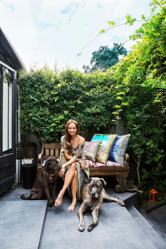 "Camilla with her beloved dogs Beau (left), a four-year-old shar pei x husky, and Gypsey, a six-year-old cane corso. Bench seat from Sharma Farms in India. [Camilla](https://www.camilla.com.au/?utm_campaign=supplier/|target=""_blank"") cushions."
