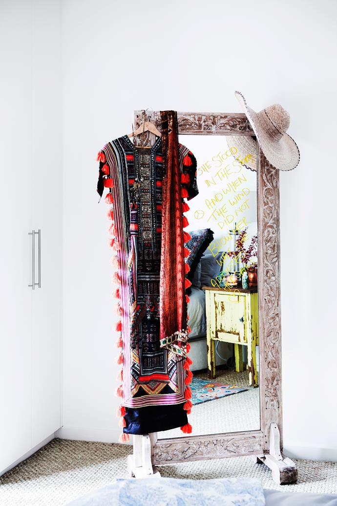 A full-length mirror highlights the exquisite detailing on 