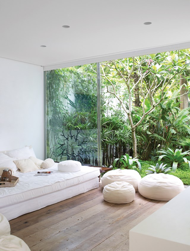 Keeping the lounge furniture low and loose allows this interior to maximise its leafy outlook, giving a virtually uninterrupted view of the garden. The sofa, covered with cushions, is really more of a day bed, adding to the casual atmosphere and the perfect place for curling up with a good book.