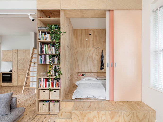 Plywood joinery separates the main bedroom from the rest of the living area in this Flinders Lane apartment by architect Clare Cousins. Photo: Lisbeth Grosmann