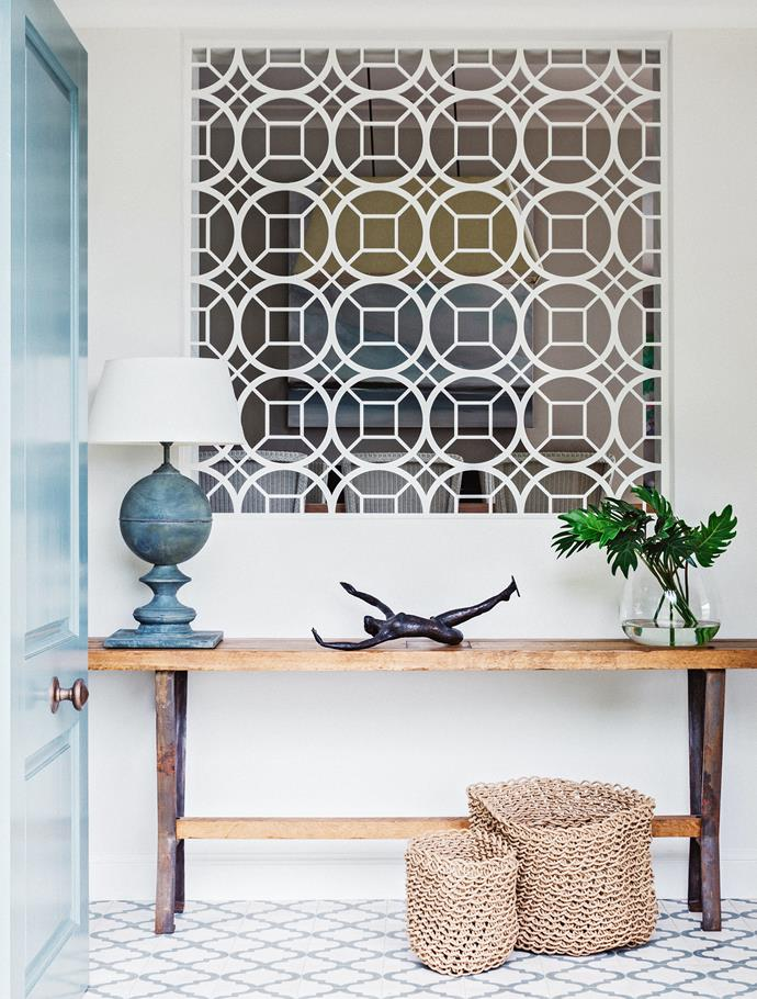 "A custom-made and designed laser-cut panel sets the tone in the entry of the [Hamptons style beach house](https://www.homestolove.com.au/diy-hamptons-style-northern-beaches-house-renovation-3585|target=""_blank""). The bronze sculpture is a family heirloom."