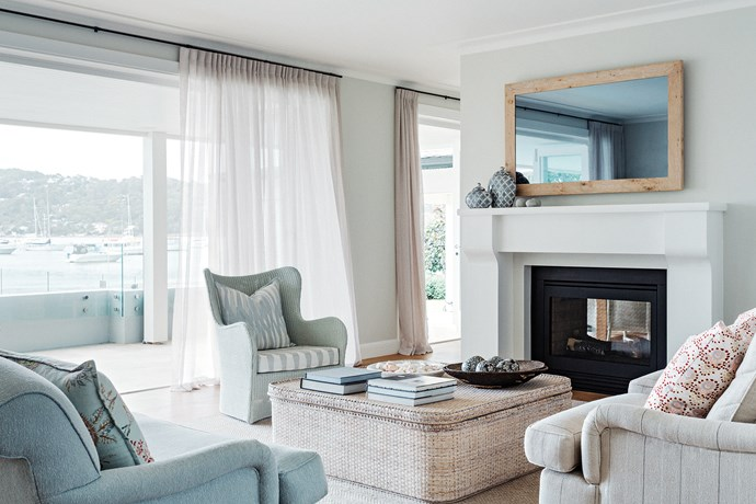 "Light and breezy living area has a 'Butterfly XL' white wicker chair and matching wicker coffee table. Oversized furniture is quintessential to the [Hamptons look](https://www.homestolove.com.au/how-to-get-the-hamptons-look-3523|target=""_blank"")."