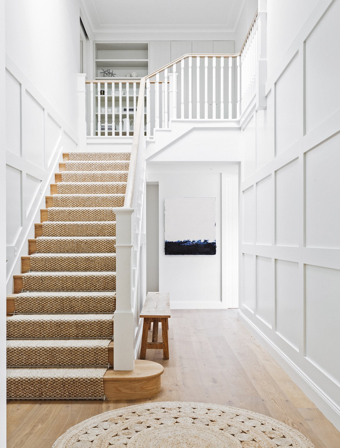 "A simple colour palette and wainscoting design has been used in this [Hamptons style home](https://www.homestolove.com.au/hamptons-style-beach-house-renovation-2380|target=""_blank"") on Sydney's North Shore."
