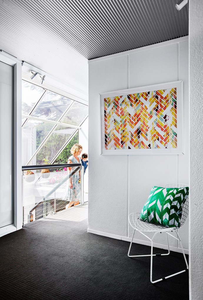 "Set under an angled glass roof, the perforated staircase directs natural light into the heart of the house.   Replica Bertoia **chair** from [Life Interiors](http://lifeinteriors.com.au/?utm_campaign=supplier/|target=""_blank""). Nancy Ramirez **print** from [One Kings Lane](https://www.onekingslane.com/?utm_campaign=supplier/
