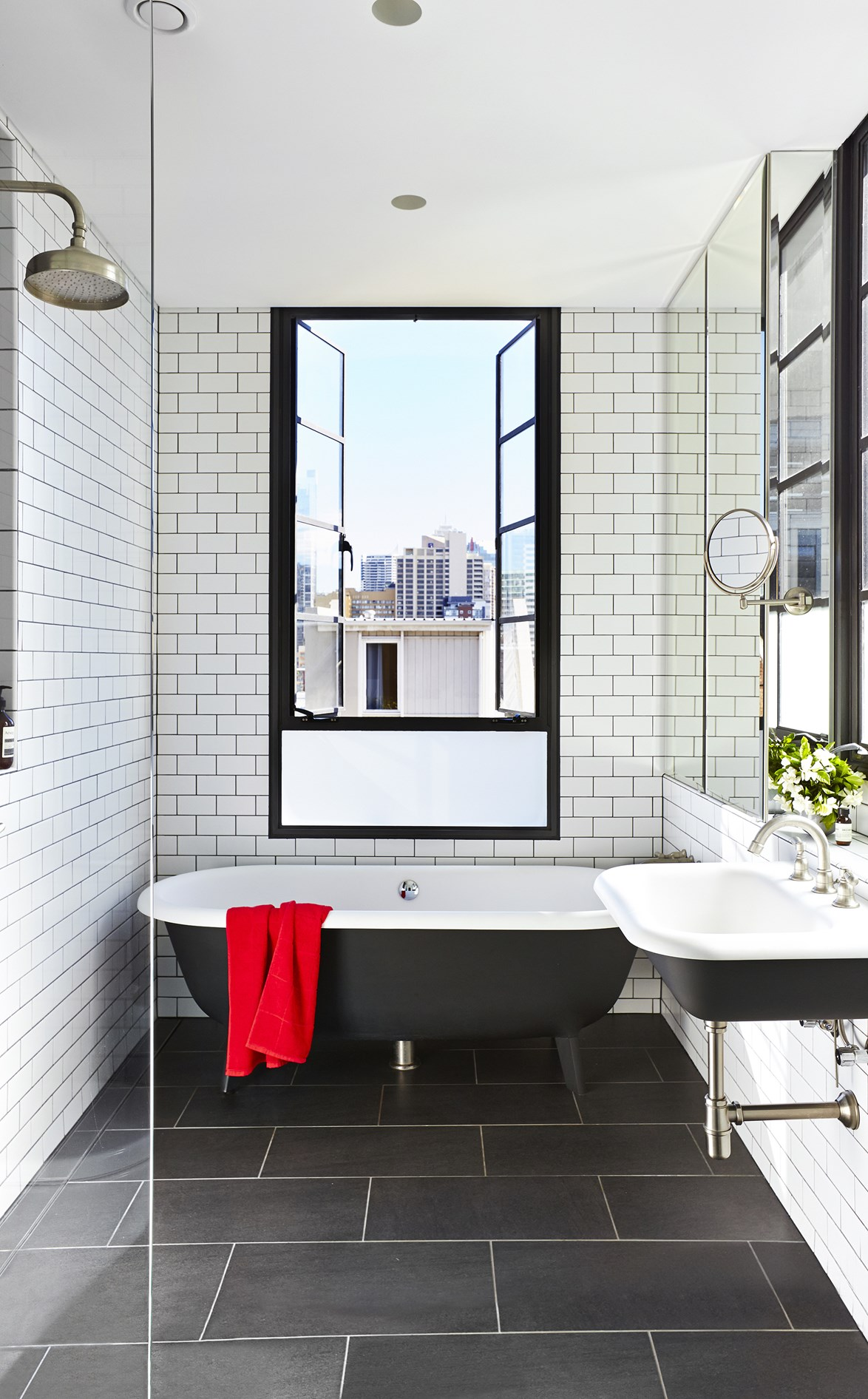 "Freestanding bath tubs, like this one in an [updated 1850s terrace house](https://www.homestolove.com.au/gallery-1850s-sydney-terrace-gets-a-modern-makeover-2396|target=""_blank"") never look out of place within a classic, black and white colour scheme. *Photo: John Paul Urizar*"