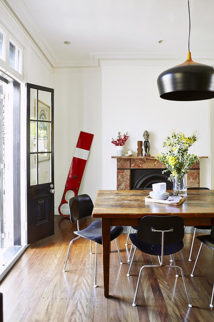 "A table of timber reclaimed from a French railway carriage connects with an old railway signal displayed as a sculptural piece. **Table** from [Original Finish](http://www.originalfinish.com.au/?utm_campaign=supplier/|target=""_blank""). Eames **chairs** from [Living Edge](http://livingedge.com.au/?utm_campaign=supplier/
