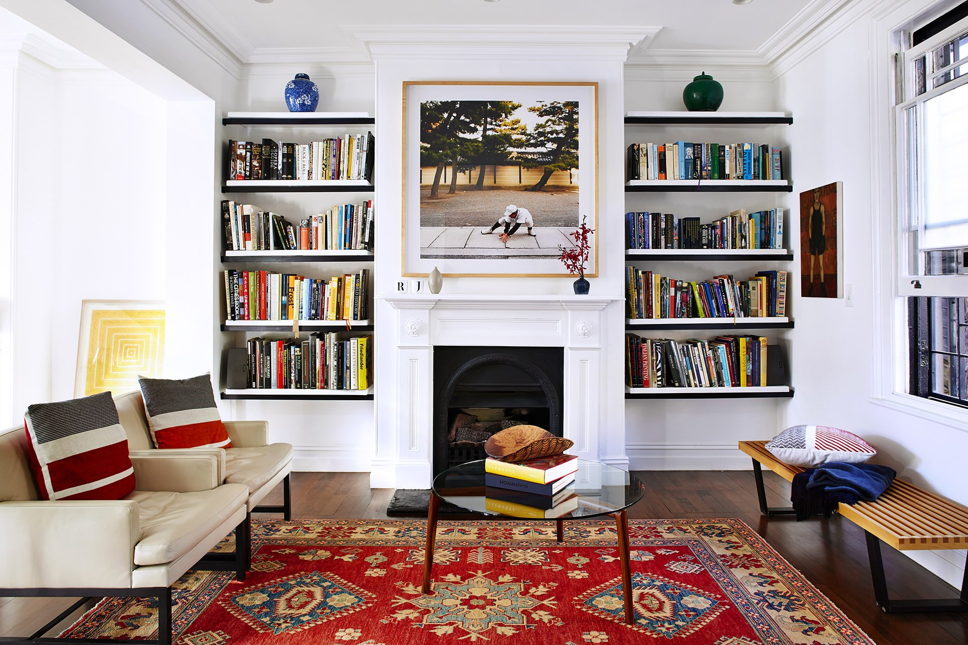 This 1850s Sydney terrace has a new lease on life after a complete exterior – and interior – renovation. Considered placement of shelving and furniture creates a sense of symmetry that suits this classic terrace. Photo: John Paul Urizar / * Australian House & Garden*
