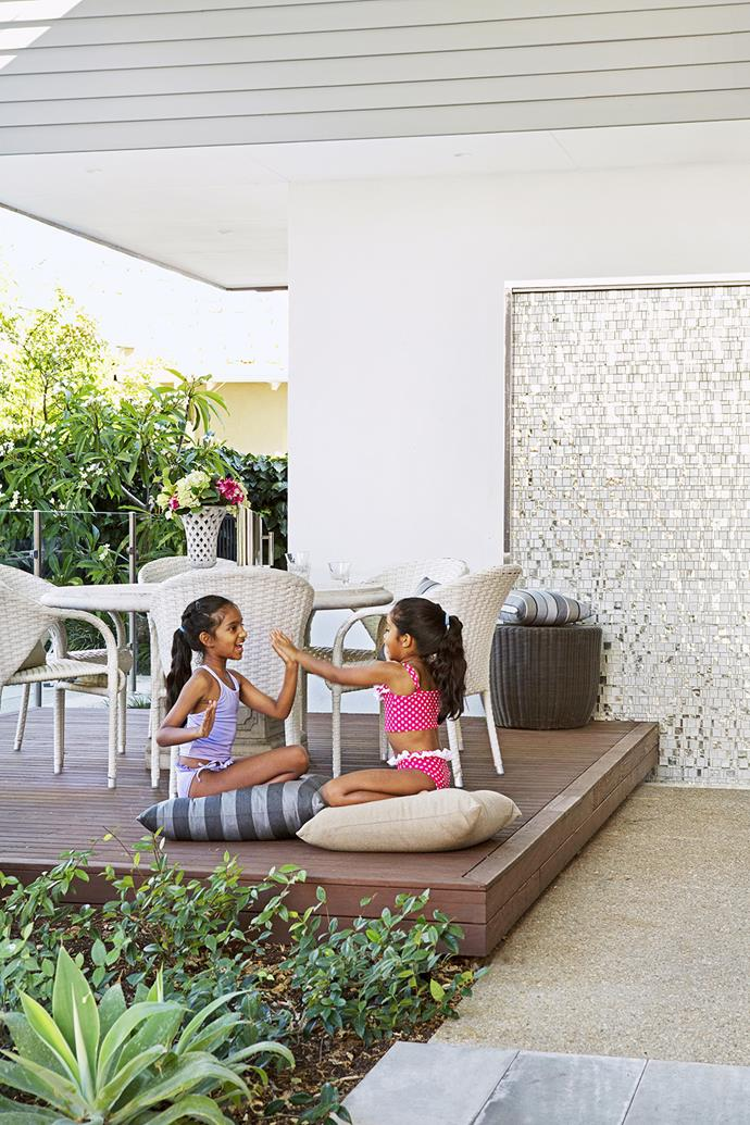 """The girls enjoy alfresco fun and games on the deck.   **Table and chairs** from [Majool](http://www.majool.com.au/?utm_campaign=supplier/