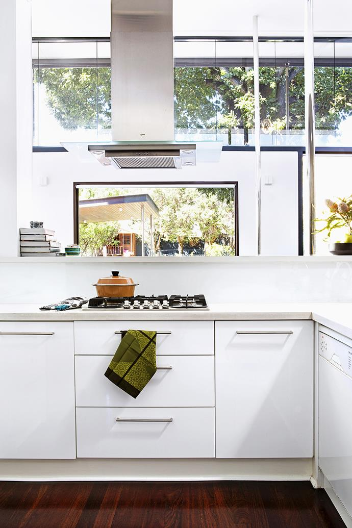 """In the kitchen, new cabinets provide plenty of hidden storage. """"There's a lot of space under the top bench, leaving the surface free to use,"""" says the owner.  **Rangehood** from [Ilve](http://ilve.com.au/?utm_campaign=supplier/