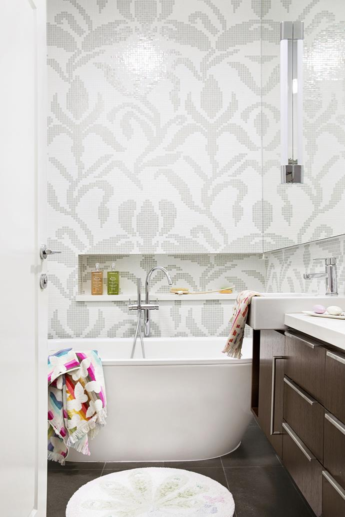 """Mosaic tiles laid in a large-scale design give the children's bathroom a touch of sumptuous grandeur that's playfully undercut by bright accessories.   **Bathtub** from [Reece](http://www.reece.com.au/?utm_campaign=supplier/