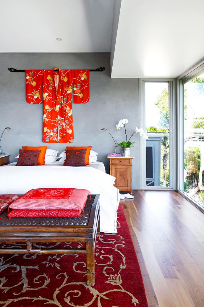 "The kimono on the wall of the main bedroom was made for Sue to wear to a wedding in Japan. ""Clean lines and a simple colour palette are very much what I took away from Japan,"" she says. **Bedlinen** from [David Jones](https://shop.davidjones.com.au/djs/en/davidjones