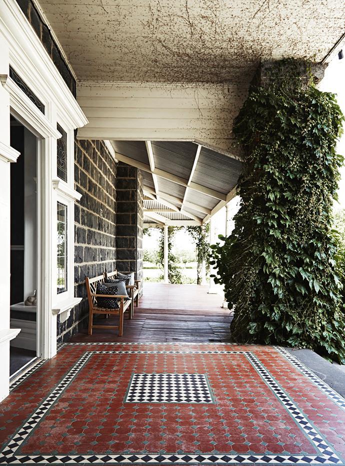 The original bluestone homestead has a tessellated tile verandah.