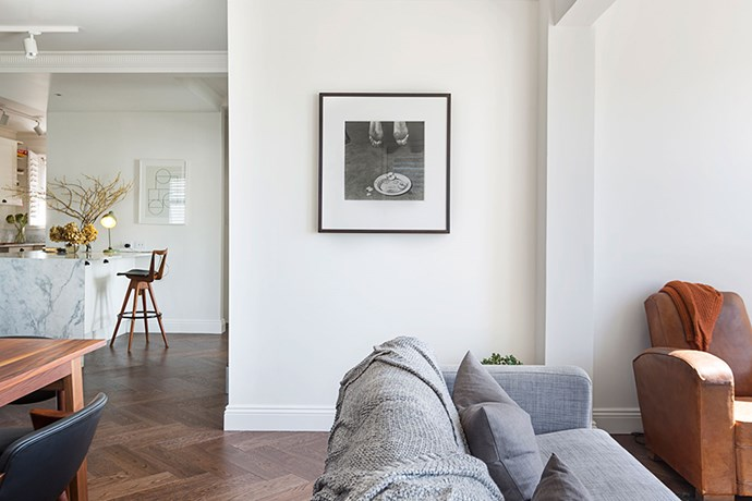 """Herringbone parquetry flooring connects the kitchen, dining and living zones. A structural beam was needed when Chloe removed walls to open up the kitchen, and the ceiling had to be lowered 50mm to house the new wiring needed to replace the """"very unsafe"""" old electricals."""