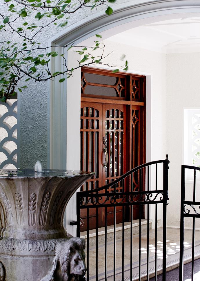 The home's graceful arched entrance has been preserved.