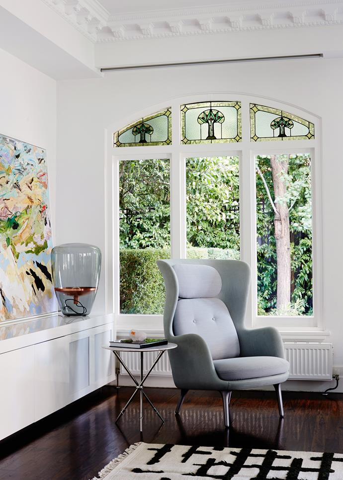 """Traditional arched windows offer restful views of the garden. Fritz Hansen Ro **chair** from [Cult](http://cultdesign.com.au/?utm_campaign=supplier/